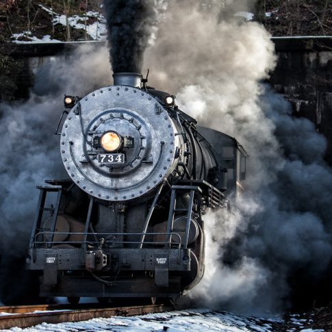 734 Western MD steam train emerging from a tunnel in a cloud of smoke