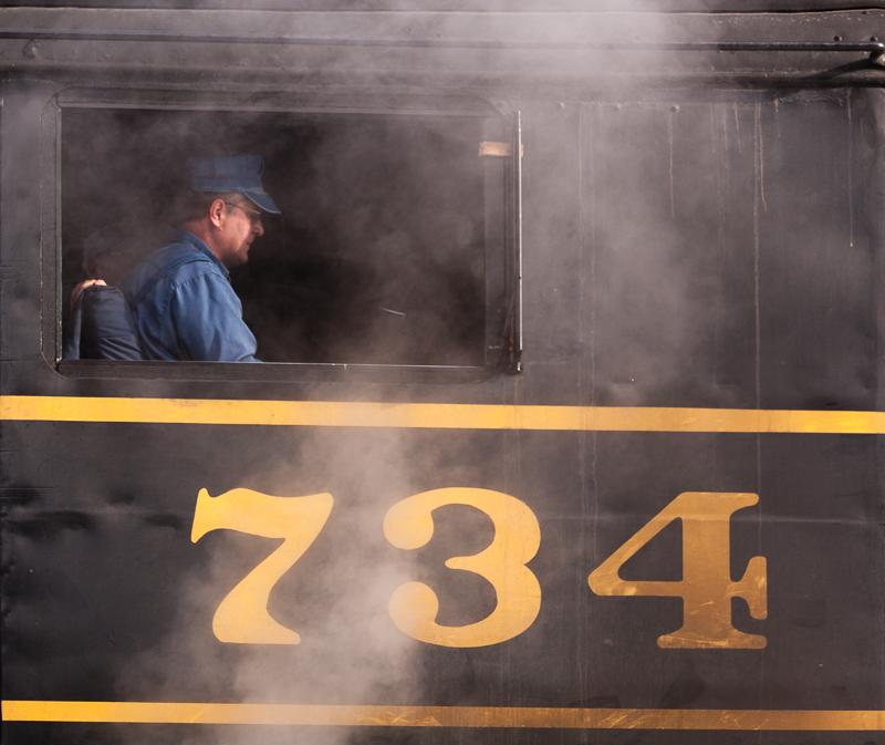 734 Western MD steam train engineer preparing the train for departure