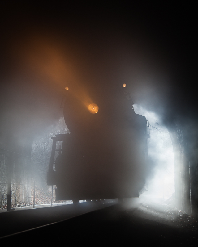 734 Western MD steam train entering a dark tunnel with headlight showing the way