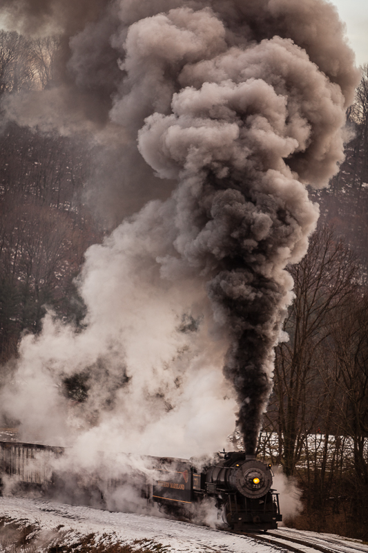 734 Western MD steam train with large soot plume and steam release