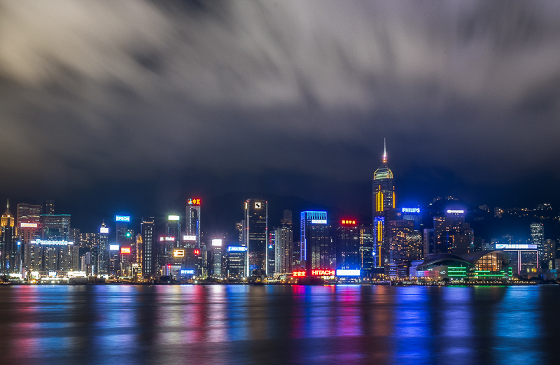 Hong Kong harbor nighttime long exposure building lights and clouds