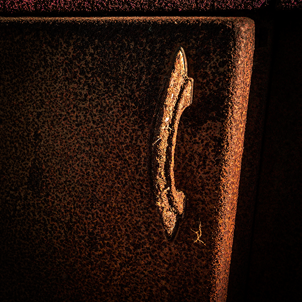 Rust covered kitchen cabinet door handle