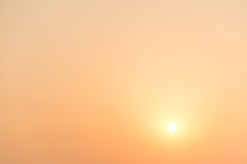 Sun obscured by smog at sunset in Suzhou China