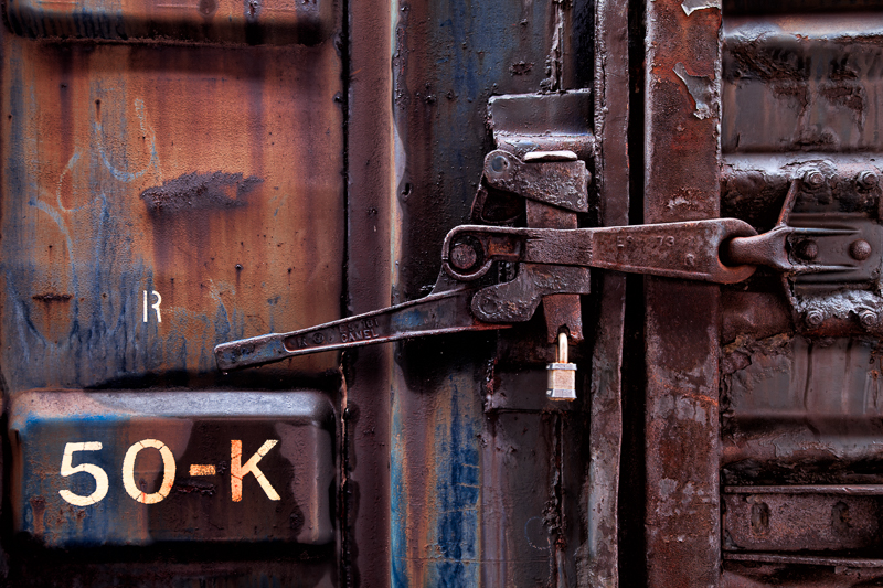 Rusty train car latch with padlock