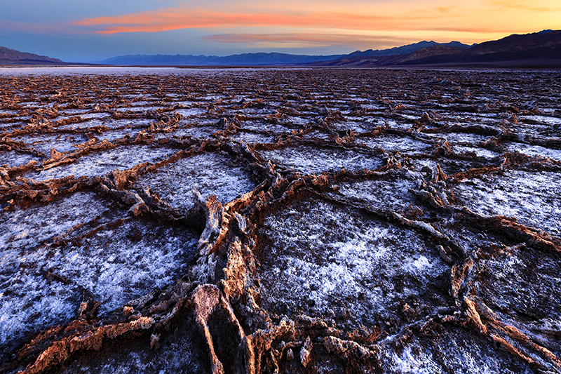 Death Valley playa at sunrise with tall brown edge salt pans
