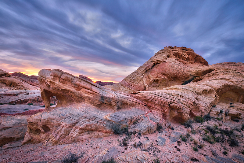 Fire Canyon arch at dusk with a dramatic sky