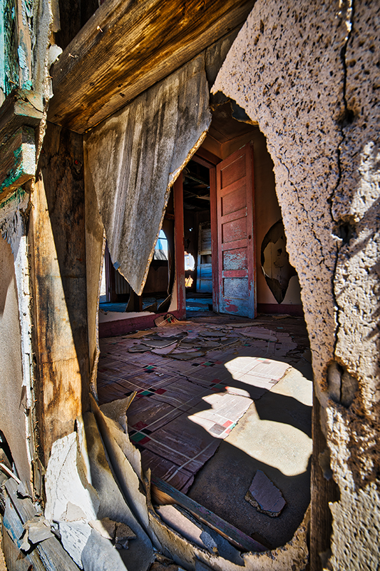 Eureka Ghost Town house looking thru a hole in the wall