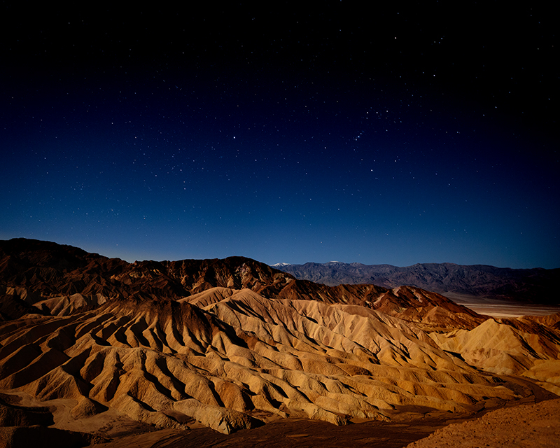 Zabriskie Point with night sky showing the constellation Orion