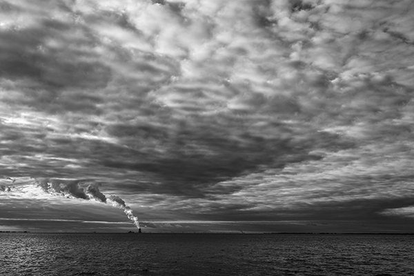 View of Salem Nuclear Power Plant with dramatic sky from Woodland Beach Dock in black and white